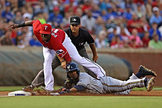 Jurickson Profar tags out Jean Segura at third base