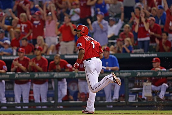 Elvis Andrus delivers a run-scoring single in the seventh