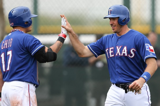 Brett Nicholas gets a high-five after a home run off Neftali Feliz