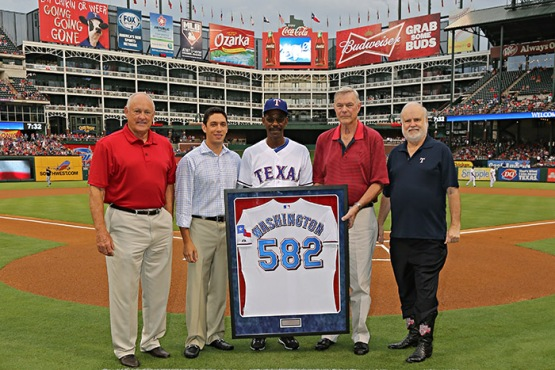 Manager Ron Washington poses with Rangers CEO Nolan Ryan, GM Jon Daniels, owners Ray Davis and Bob Simpson at Rangers Ballpark in Arlington.  Washington was honored for becoming the winningest manager in franchise history on August 13, 2013, surpassing Bobby Valentine's record of 581 victories.
