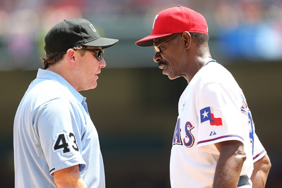Rangers Manager Ron Washington has words with umpire Paul Schrieber at Rangers Ballpark in Arlington on June 16, 2013