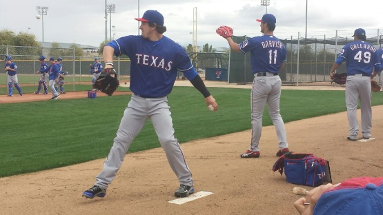 Derek Holland throwing on Monday with Yu Darvish